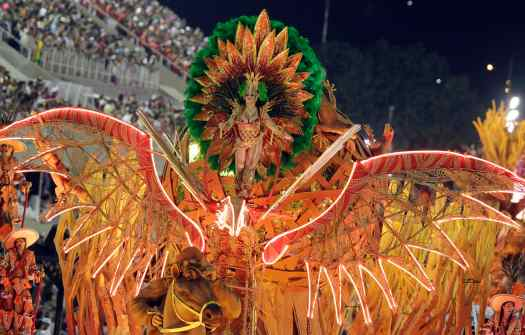 A reveller from the Salgueiro samba school takes part in a parade on the second night of the annual Carnival parade in Rio de Janeiro's Sambadrome